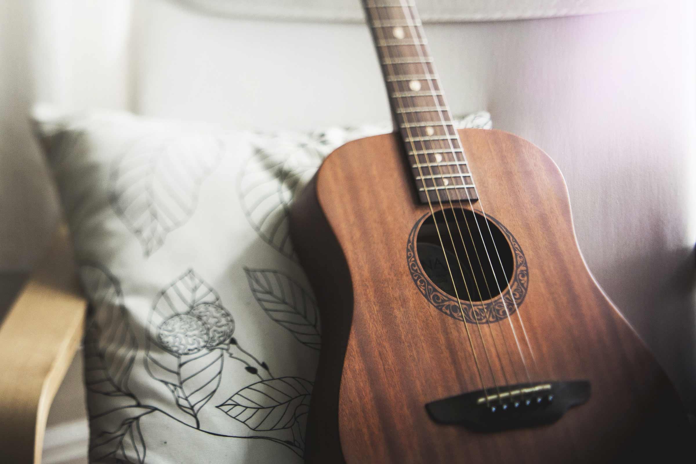 Playing Six String Guitar